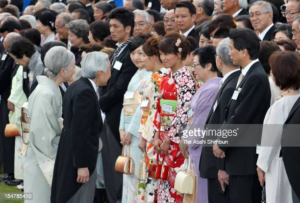 Emperor Akihito speaks to London Olympic Judo Women's 57kg gold medalist Kaori Matsumoto while Empress Michiko speaks to three times Olympic gold...