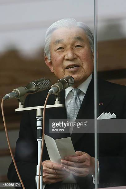 Emperor Akihito speaks to wellwishers during the celebration for the New Year on the veranda of the Imperial Palace on January 2 2015 in Tokyo Japan