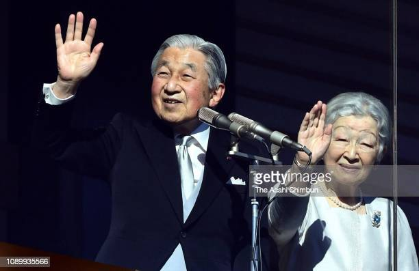 Emperor Akihito, standing beside Empress Michiko, waves to well-wishers during his final New Year Greeting at the Imperial Palace on January 02, 2019...