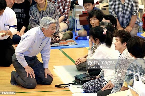 Emperor Akihito talks to evacuees at Minamiaso Junior High School gymnasium where people take shelter on May 19 2016 in Minamiaso Kumamoto Japan The...
