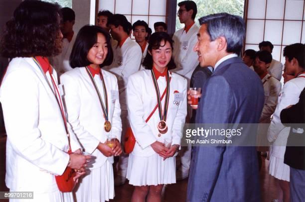 Emperor Akihito talks to Kyoko Iwasaki and Fumiko Okuno during a tea party at the Akasaka Palace on September 28 1992 in Tokyo Japan
