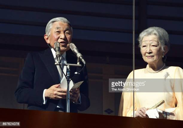 Emperor Akihito talks to wellwishers along with Empress Michiko as he turns 84 at the Imperial Palace on December 23 2017 in Tokyo Japan