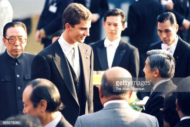 Emperor Akihito talks with Crown Prince Felipe of Spain during the garden party celebrating his Enthronement at the Akasaka Imperial Garden on...