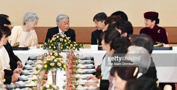 Emperor Akihito talks with Empress Michiko Crown Prince Naruhito and Crown Princess Masako during a banquet celebrating his 84th birthday at the...