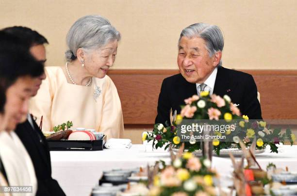 Emperor Akihito talks with Empress Michiko during a banquet celebrating his 84th birthday at the Imperial Palace on December 23 2017 in Tokyo Japan