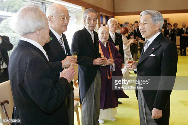 Emperor Akihito talks with guests at the tea party inviting the Order of Culture laureates at the Imperial Palace on November 6 2006 in Tokyo Japan