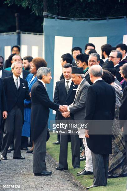 Emperor Akihito talks with guests during the garden party celebrating his Enthronement at the Akasaka Imperial Garden on November 13 1990 in Tokyo...