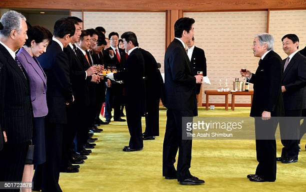 Emperor Akihito talks with Prime Minister Shinzo Abe while Crown Prince Naruhito listens prior to the luncheon inviting cabinet members at the...