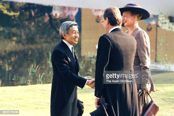 Emperor Akihito talks with Queen Margrethe II and her husband Prince Henrik of Denmark during the garden party celebrating his Enthronement at the...