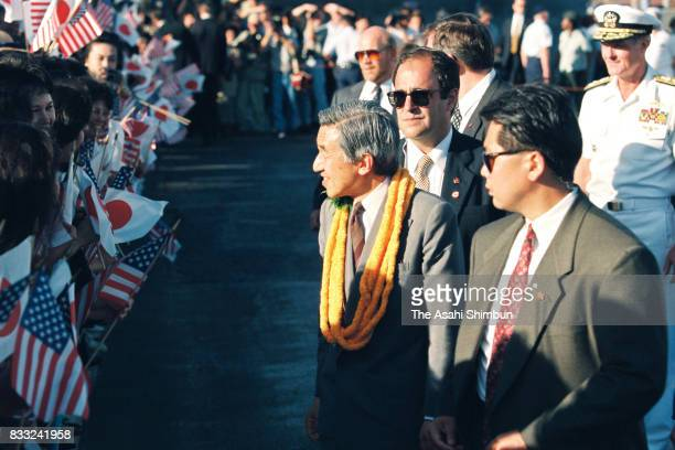 Emperor Akihito talks with wellwishers on arrival at the US Air Force Hickam Field on June 23 1994 in Honolulu Hawaii