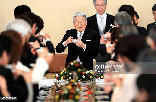 Emperor Akihito toasts a glass with guests at a banquet at the Imperial Palace on December 23 2016 in Tokyo Japan