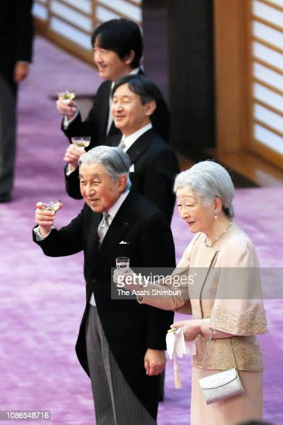 Emperor Akihito toasts glass with Empress Michiko, Crown Prince Naruhito and Prince Akishino on his 85th birthday at the Imperial Palace on December...