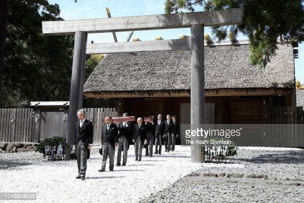 Emperor Akihito visits the Naiku, inner shrine while chamberlains hold a legendary sword and a jewel at Ise Shrine on April 18, 2019 in Ise, Mie,...