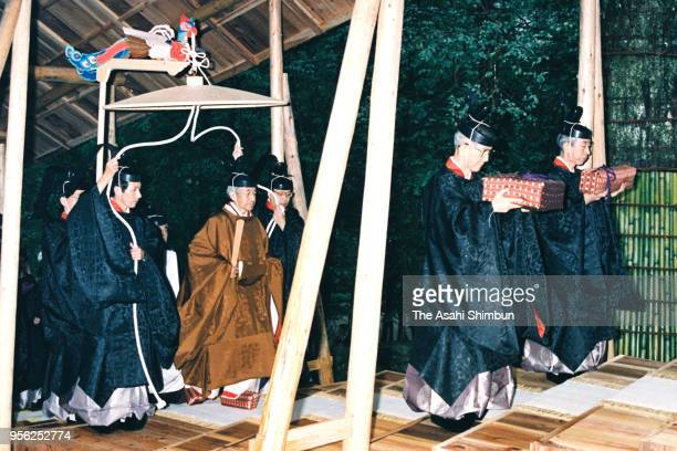 Emperor Akihito walks on a makeshift corridor to visit the Naiku Inner Shrine during the 'Shinetsunogi' first visit after Emperor Akihito's...