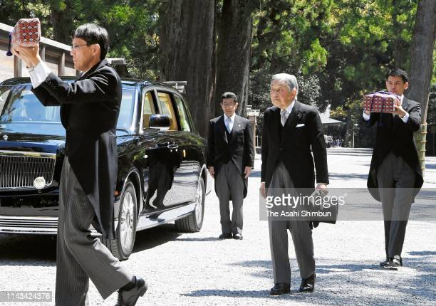 Emperor Akihito walks through the gate of the Geku, outer shrine with chamberlains holding a legendary sword and a jewel at Ise Shrine on April 18,...