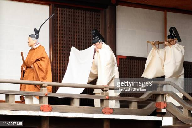 Emperor Akihito walks to the Kasukodokoro one of the Imperial Sanctuaries for the 'Taiirei Tojitsu Kashikodokoro Omae no Gi' ceremony to report...