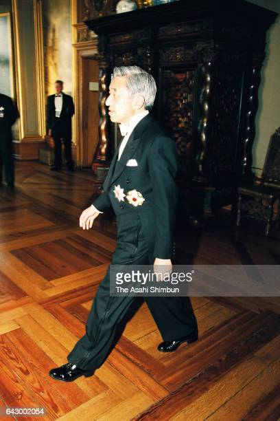 Emperor Akihito walks to welcome guests prior to the return dinner hosted by Japanese emperor and empress at Frederiksborg Castle on June 3, 1998 in...