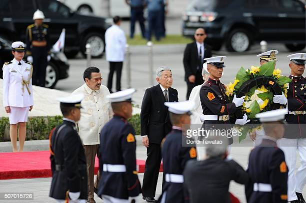 Emperor Akihito walks with Manila Mayor Joseph Estrada as they offer a wreath of flowers at the monument of Philippine national hero Jose Rizal on...