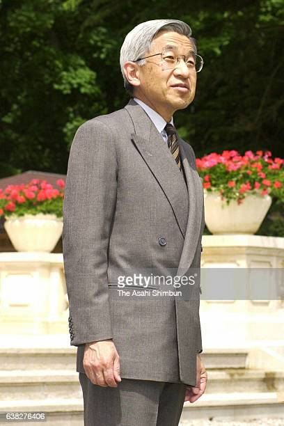 Emperor Akihito watches Lake Geneva at the official residence of the Permanent Representative of Japan to the International Organizations in Geneva...