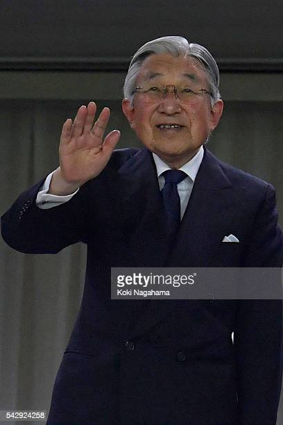 Emperor Akihito waves to the audience and players during the international friendly match between Japan v Scotland at Ajinomoto Stadium on June 25...