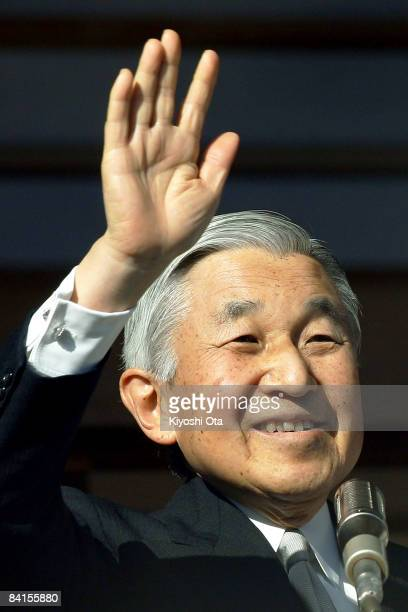 Emperor Akihito waves to the wellwishers celebrating the New Year at the Imperial Palace on January 2 2009 in Tokyo Japan About 52000 people visited...