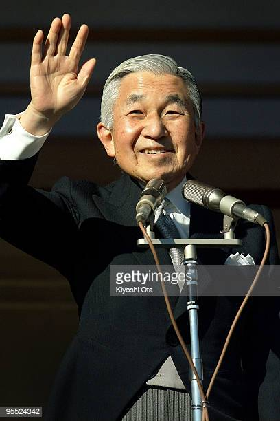 Emperor Akihito waves to the wellwishers celebrating the New Year at the Imperial Palace on January 2 2010 in Tokyo Japan