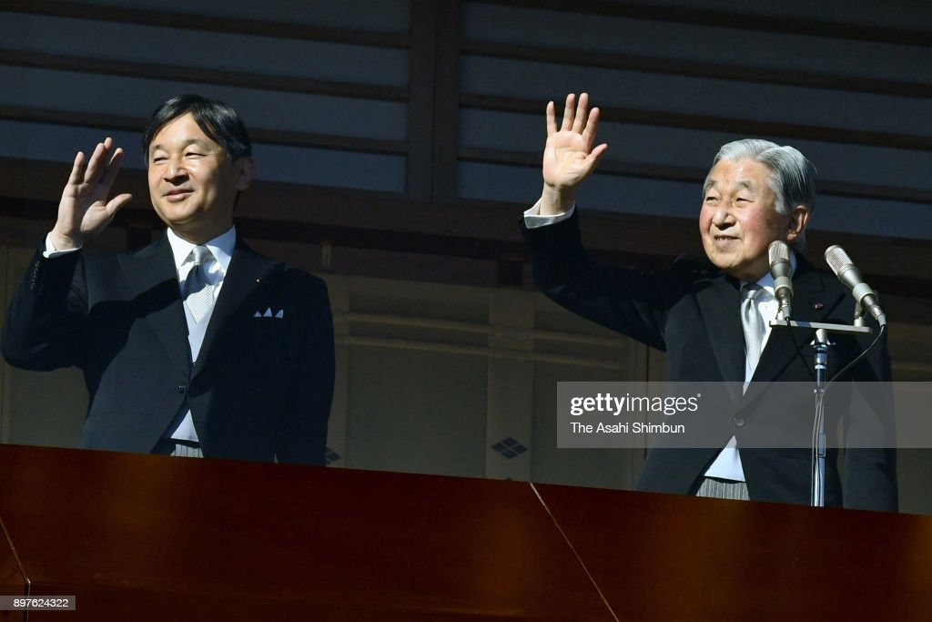 Emperor Akihito (R) waves to well-wishers along with Crown Prince Naruhito (L) as he turns 84 at the Imperial Palace on December 23, 2017 in Tokyo, Japan.