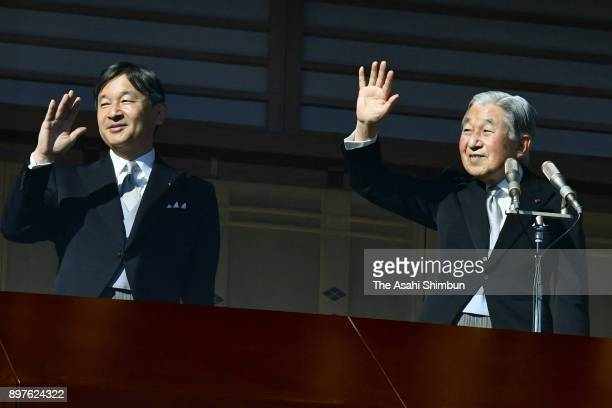 Emperor Akihito waves to wellwishers along with Crown Prince Naruhito as he turns 84 at the Imperial Palace on December 23 2017 in Tokyo Japan