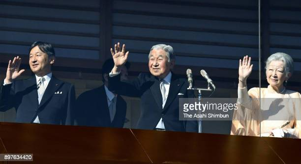 Emperor Akihito waves to wellwishers along with Empress Michiko and Crown Prince Naruhito as he turns 84 at the Imperial Palace on December 23 2017...