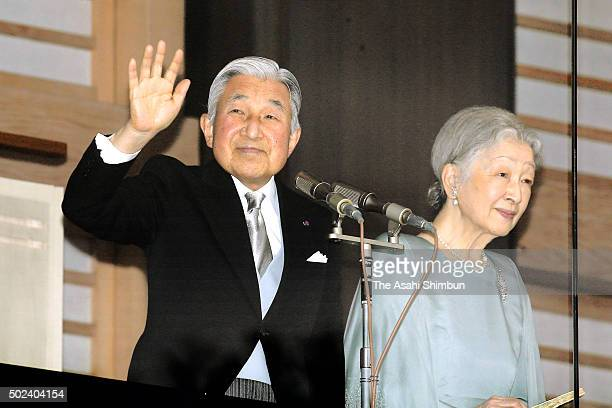Emperor Akihito waves to wellwishers along with Empress Michiko as he celebrates his 82nd birthday at the Imperial Palace on December 23 2015 in...