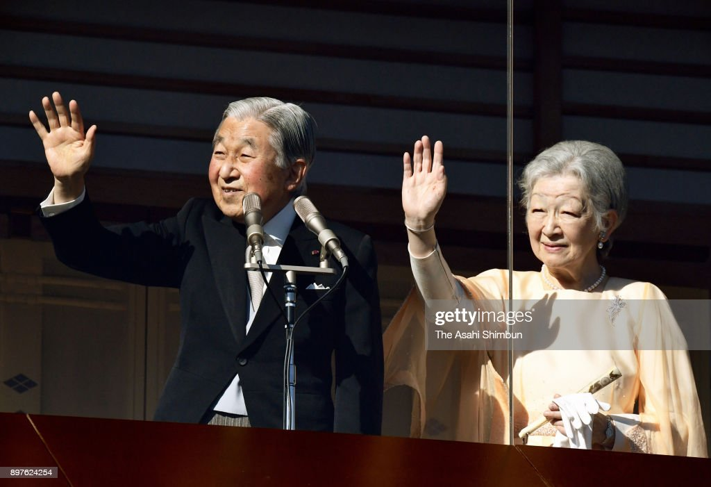 Emperor Akihito waves to well-wishers along with Empress Michiko as he turns 84 at the Imperial Palace on December 23, 2017 in Tokyo, Japan.