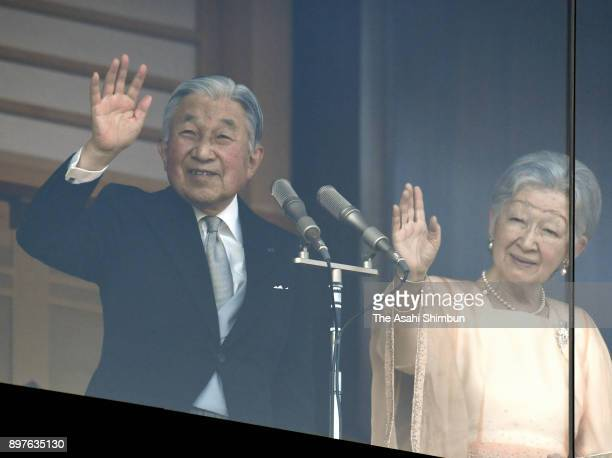 Emperor Akihito waves to wellwishers along with Empress Michiko as he turns 84 at the Imperial Palace on December 23 2017 in Tokyo Japan