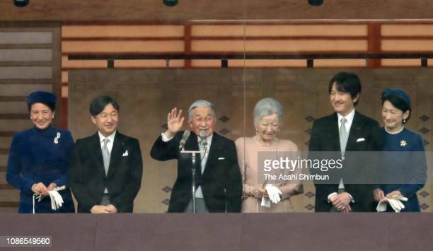 Emperor Akihito waves to well-wishers along with Empress Michiko, Crown Prince Naruhito, Crown Princess Masako, Prince Akishino and Princess Kiko of...