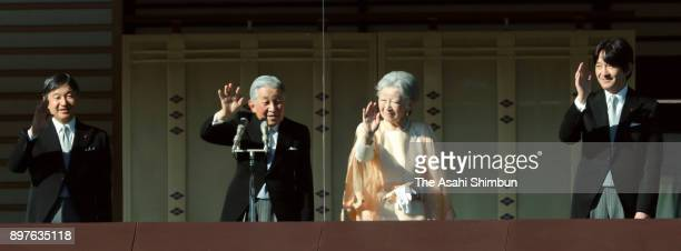 Emperor Akihito waves to wellwishers along with Empress Michiko Crown Prince Naruhito and Prince Akishino as he turns 84 at the Imperial Palace on...