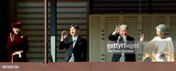 Emperor Akihito waves to wellwishers along with Empress Michiko Crown Prince Naruhito and Crown Princess Masako as he turns 84 at the Imperial Palace...