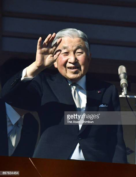 Emperor Akihito waves to wellwishers as he turns 84 at the Imperial Palace on December 23 2017 in Tokyo Japan