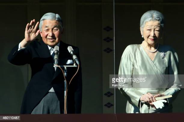 Emperor Akihito waves to wellwishers next to Empress Michiko during celebrations for the New Year on the veranda of the Imperial Palace on January 2...