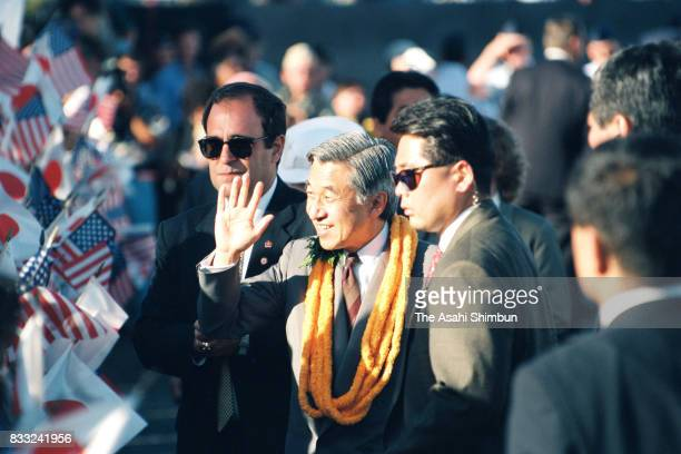 Emperor Akihito waves to wellwishers on arrival at the US Air Force Hickam Field on June 23 1994 in Honolulu Hawaii