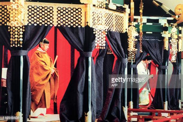 Emperor Akihito wearing a traditional Japanese costume stands inside the Takamikura during the enthronement ceremony at the Imperial Palace November...
