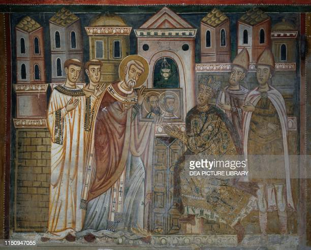Emperor Constantine with leprosy kneeling in front of Pope Sylvester I fresco in St Sylvester Oratory inside Santi Quattro Coronati Basilica Rome...