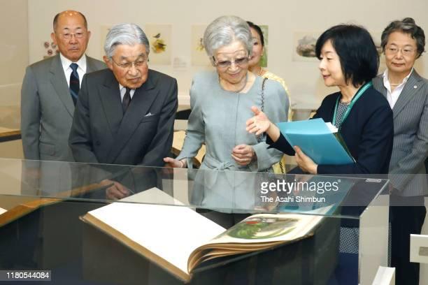 Emperor Emeritus Akihito and Empress Emerita Michiko are briefed by their daughter and ornithologist Sayako Kuroda as they visit the John Gould...