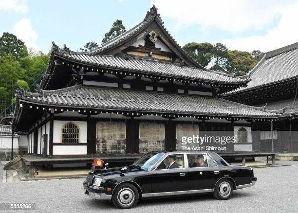 Emperor Emeritus Akihito and Empress Emerita Michiko are seen on arrival at Sennyuji Temple to visit the mausoleum of Emperor Komei on June 12, 2019...