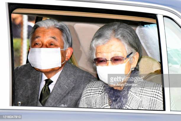 Emperor Emeritus Akihito and Empress Emerita Michiko wearing face masks amid the coronavirus pandemic are seen on arrival at their temporary home at...