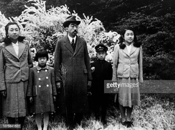 Emperor Hiro Hito pose with 4 of these 5 childrens Prince Akihito and his sisters Princess Shigeko of Teru Princess Atsuko of Yori and Princess...