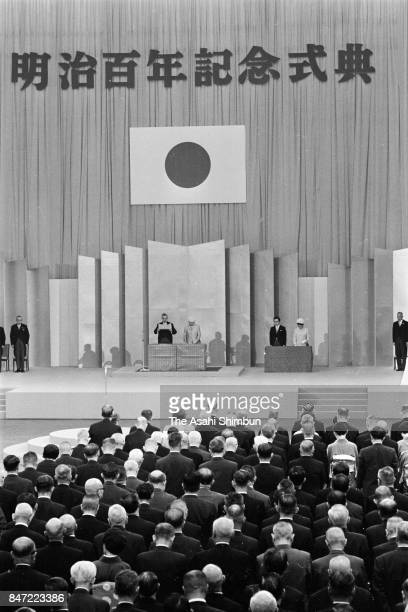 Emperor Hirohito addresses remarks while Empress Nagako listens during the Meiji Centenary Memorial Ceremony at Nippon Budokan on October 23 1968 in...
