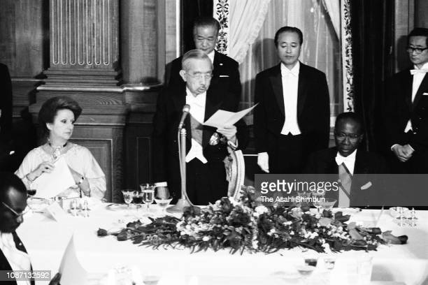 Emperor Hirohito addresses while Senegalese President Leopold Sedar Senghor and his wife Colette Hubert Senghor listen during the welcome dinner at...