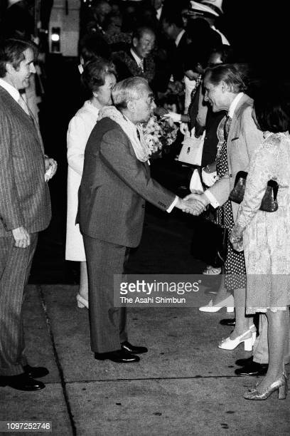 Emperor Hirohito and Empress Nagako are seen on arrival at Honolulu Airport on October 10 1975 in Honolulu Hawaii