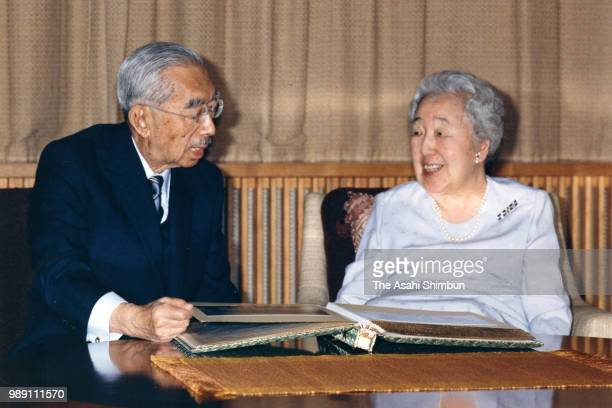 Emperor Hirohito and Empress Nagako attend a photo session at the Imperial Palace on December 11, 1987 in Tokyo, Japan.