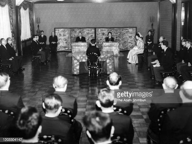 Emperor Hirohito and Empress Nagako attend the 'KoshoHajimenoGi' first lecture of the New Year at the Imperial Palace on January 8 1964 in Tokyo Japan