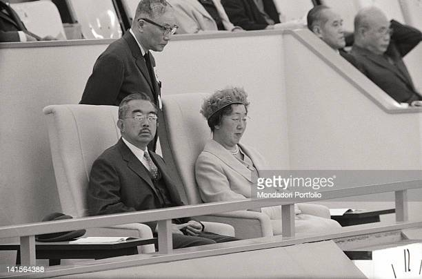 Emperor Hirohito and Empress Nagako attend the opening ceremony of the Nippon Budokan on October 3, 1964 in Tokyo, Japan.
